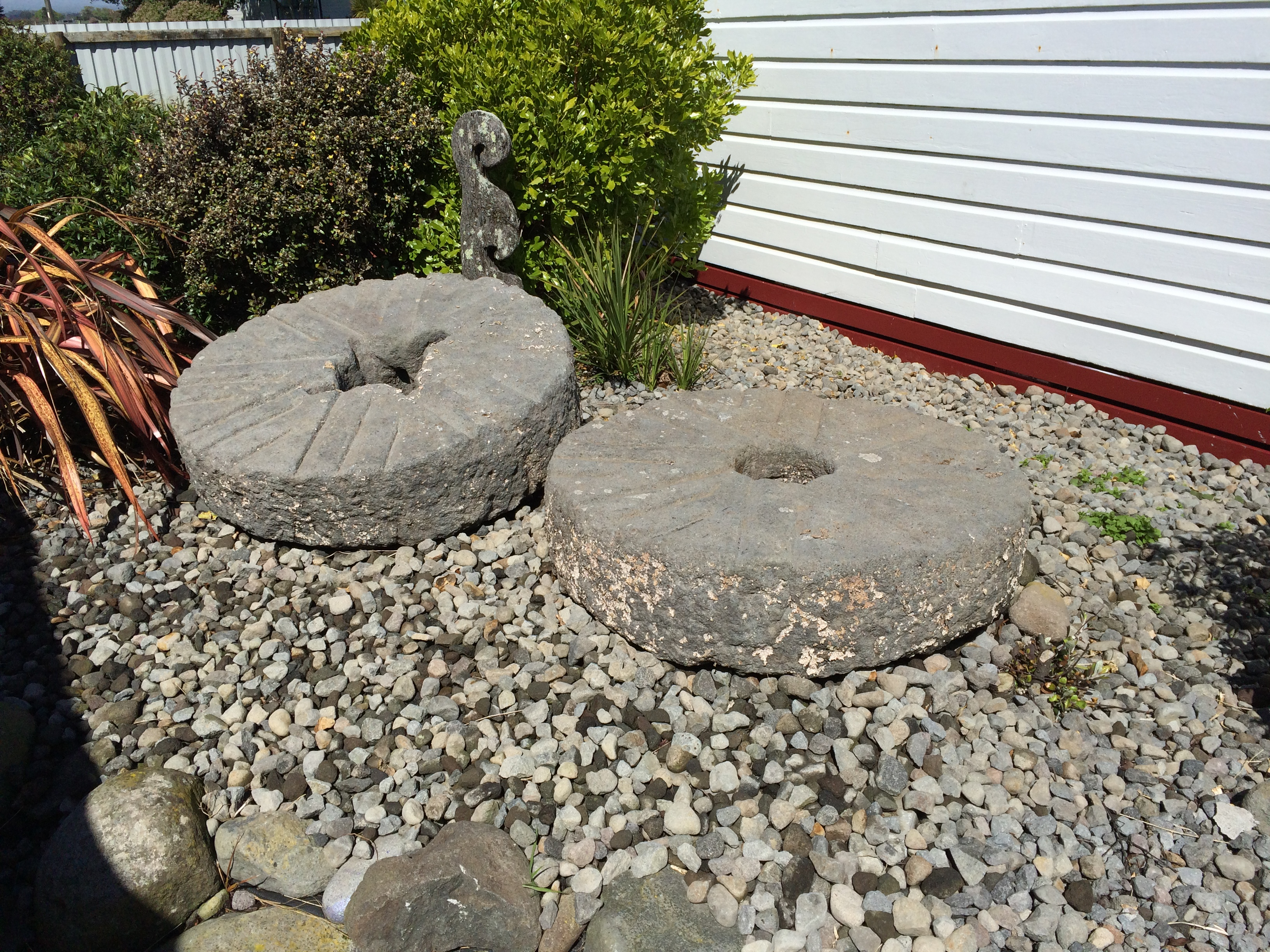 Mill stones at Puniho Marae