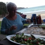 Kai at the beach .Professor Lorna Earl serving the salad.